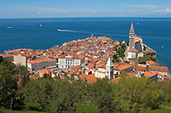 View over the roof tops with sea in the distance. Piran , Slovenia Visit our PHOTO COLLECTIONS OF SLOVANIAN  HISTOIC PLACES for more photos to download or buy as wall art prints https://funkystock.photoshelter.com/gallery-collection/Pictures-Images-of-Slovenia-Photos-of-Slovenian-Historic-Landmark-Sites/C0000_BlKhcYWnT4Sites/C0000qxA2zGFjd_k