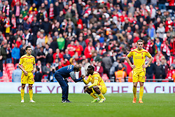 Liverpool players including Mario Balotelli and Jordan Henderson look dejected after Aston Villa win the match 2-1 to reach the 2015 FA Cup Final - Photo mandatory by-line: Rogan Thomson/JMP - 07966 386802 - 19/04/2015 - SPORT - FOOTBALL - London, England - Wembley Stadium - Aston Villa v Liverpool - FA Cup Semi Final.