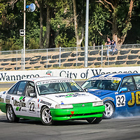 Ken Coppin ploughs into a sideways Glen Baker's VN Commodore Saloon Car coming out of the final corner at Wanneroo Raceway.