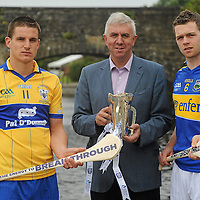 26 July 2010; Tipperary captain Padraic Maher, right, and John Conlon, left, Clare captain, with Ger Cunningham, Sports Sponsorship manager Bord Gáis Energy, met halfway on the bridge at Killaloe, Co. Clare and Ballina, Co. Tipperary ahead of Wednesday night's Bord Gáis Energy Munster GAA Hurling U-21 Final.Tipperary will look to upset current Munster and All-Ireland champions Clare on home turf at Semple Stadium, where throw in is at 7.30pm. Killaloe, Co. Clare. Picture credit: David Maher / SPORTSFILE *** NO REPRODUCTION FEE ***