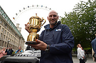England rugby legend Lawrence Dallaglio holds up the Webb Ellis Trophy. RWC 2015, Coca Cola London Eye launch for the Rugby World cup event  in London on Tuesday 15th Sept  2015.<br /> pic by John Patrick Fletcher, Andrew Orchard sports photography.