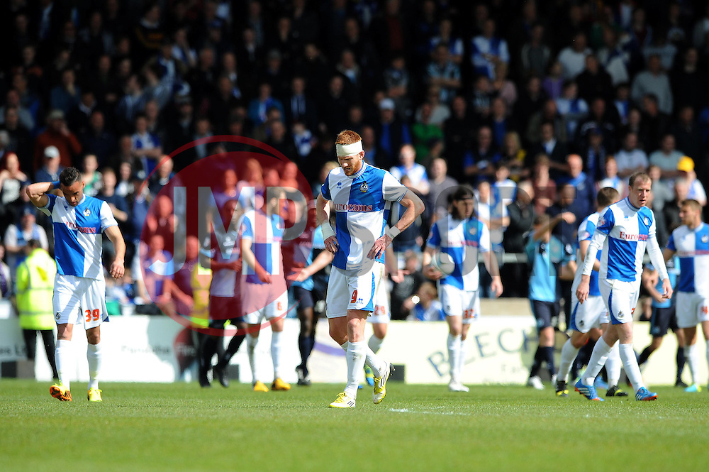 Bristol Rovers' players cut dejected figures as Wycombe Wanderers' score to make it 1 - 1 - Photo mandatory by-line: Dougie Allward/JMP - Mobile: 07966 386802 26/04/2014 - SPORT - FOOTBALL - High Wycombe - Adams Park - Wycombe Wanderers v Bristol Rovers - Sky Bet League Two