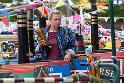 Little Venice, London, April 30th 2017. Narrowboaters from all over the uK gather for the annual Canalway Cavalcade, held on the May Day Bank holiday weekend, organised by the Inland Waterways Association, where boaters get the chance to display their immaculately prepared and brightly painted craft as well as compete in various manoeuvring tests. PICTURED: A woman works on her narrowboat.<br /> Credit: ©Paul Davey<br /> To licence contact: <br /> Mobile: +44 (0) 7966 016 296<br /> Email: paul@pauldaveycreative.co.uk<br /> Twitter: @pauldaveycreate