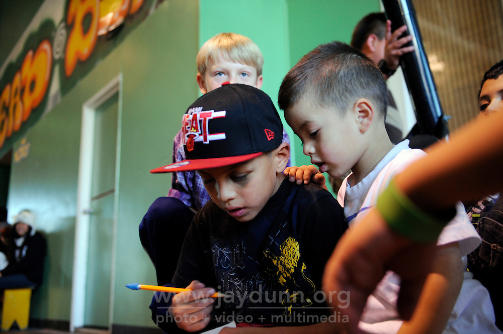 Kevin Hernandez, 8, sporting a black eye, and friends have a safe place to play thanks to the Breadbox Recreation Center, a City of Salinas facility. The same building houses Second Chance and the Alisal Center for Fine Arts.