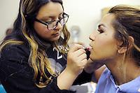 Jessica Ruiz, 18, practices her cosmetology skills on transgender prom queen Angie Esteban in their Regional Occupational Program (ROP) class in Salinas.