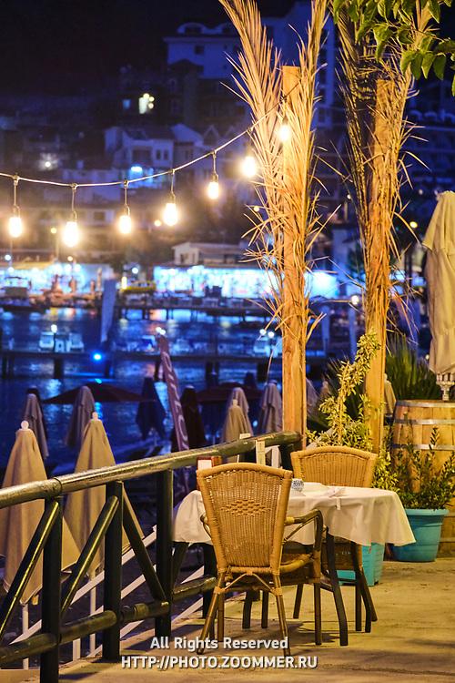 Restaurant table near the Aegean sea at night, Turunc, Turkey
