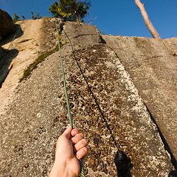 Rock climbing near the top of Cathedral Ledge.  Echo Lake State Park in North Conway, New Hampshire.  White Mountains.