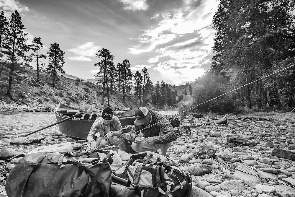 Packing at first light ensures everything in the boat will be in top order. Brandon and Rochelle Hoffner of the Henry's Fork Foundation check tipets and flies before mounting up in their McKenzie drift boat down the Middle Fork of the Salmon River.