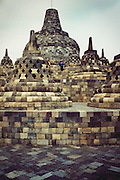 Buddhist stone monument in Borobudur, Indonesia. <br /> <br /> Editions:- Open Edition Print / Stock Image