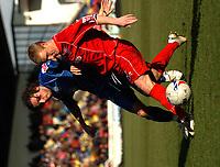 Photo: Ian Hebden.<br />Rushden & Diamonds v Grimsby Town. Coca Cola League 2. 04/03/2006.<br />Rushden's Ronnie Bull (R) shields the ball from Grimsby's Michael Reddy (L).