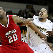 Louisiana's center Courtney Wallace (20) and Central Florida forward Dwight McCombs (10) fight for a rebound during their game at the UCF Arena on December 15, 2010 in Orlando, Florida. UCF won the game79-58. (AP Photo/Alex Menendez)