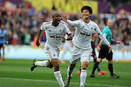 Andre Ayew of Swansea city celebrates with Ki Sung-Yueng after he scores his teams 1st goal. Barclays premier league match, Swansea city v Tottenham Hotspur at the Liberty Stadium in Swansea, South Wales on Sunday 4th October 2015.<br /> pic by  Andrew Orchard, Andrew Orchard sports photography.