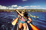High school girls paddling an outrigger canoe. Kaunakakai, Molokai.