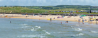 GV, general view, bathers, East Strand, Portrush, Co Antrim, N Ireland, UK, 201406213173<br /> <br /> Copyright Image from Victor Patterson, 54 Dorchester Park, Belfast, UK, BT9 6RJ<br /> <br /> Tel: +44 28 9066 1296<br /> Mob: +44 7802 353836<br /> Voicemail +44 20 8816 7153<br /> w: victorpatterson.com<br /> <br /> e1: victorpatterson@me.com<br /> e2: victorpatterson@gmail.com<br /> <br /> <br /> IMPORTANT: Please see my Terms and Conditions of Use at www.victorpatterson.com