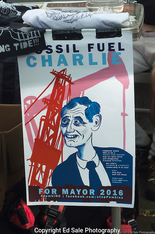 May Day 2015 protest sign titled Fossil Fuel Charlie derides Portland, Oregon mayor Charles Hales for support of a proposed propane export terminal.
