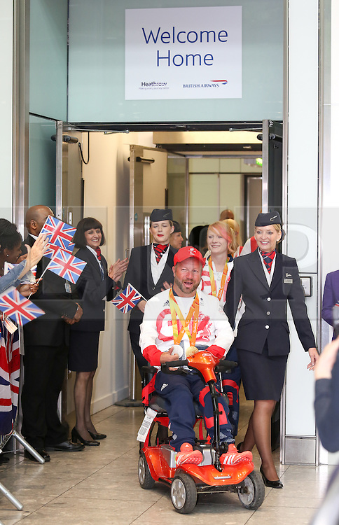 © Licensed to London News Pictures. 20/09/2016. London, UK. Team GB Paralympian Lee Pearson arrives at terminal 5 of London Heathrow Airport after flying on British Airways flight BA2016. Team GB finished second in the Paralympics medals table with 147 medals beating their total of 120 at London 2012. Photo credit : Tom Nicholson/LNP