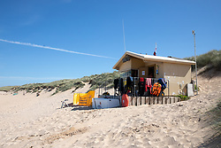 © Licensed to London News Pictures. 29/05/2020. Padstow, UK. General view of Constantine Bay RNLI Lifeguard hut, as RNLI Lifeguards resume service on Constantine beach on the north coast of Cornwall this morning, as one of a select few beaches. Up until today, the RNLI have not been providing a lifeguard service in Cornwall, due to Coronavirus (COVID-19). The weather in the south-west is forecast to be warm over the weekend, with highs of 23 degrees Celsius. Photo credit : Tom Nicholson/LNP