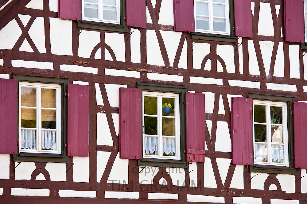Windows and wooden shutters of quaint timber-framed house in Schiltach in the Bavarian Alps, Germany