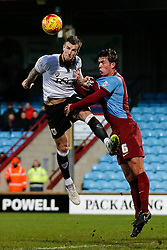 Aden Flint of Bristol City is challenged by Niall Canavan of Scunthorpe United - Photo mandatory by-line: Rogan Thomson/JMP - 07966 386802 - 17/01/2015 - SPORT - FOOTBALL - Scunthorpe, England - Glanford Park - Scunthorpe United v Bristol City - Sky Bet League 1.