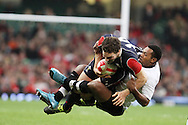 George North of Wales is tackled by Taniela Rawaqa of Fiji (r). Invesco Perpetual series, Wales v Fiji , rugby international match at the Millennium Stadium in Cardiff on Friday 19th Nov 2010.  pic by Andrew Orchard, Andrew Orchard sports photography,