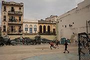 A group of children plays ball in  Havana, Cuba.
