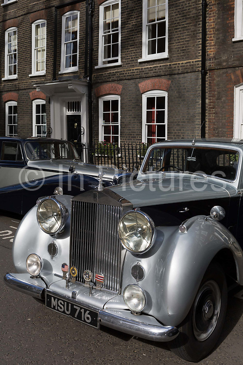 A 1954 Rolls-Royce Silver Dawn is parked in Smith Square, a small square behind the Houses of Parliament, before collecting its VIP passengers - barristers who are being sworn in as QCs aka Silks in legal vernacular, on 11th March 2019, in London, England.
