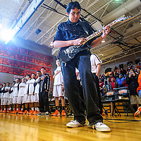 012913  Adron Gardner<br /> <br /> Byron Lee strums the Star Spangled Banner on his Ibanez electric guitar to open the Gallup Bengal basketball game against the Lost Lunas Tigers  at Gallup High School Tuesday.