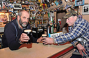22-1-2013: Kerry County Councilllor Danny Healy-Rae pulling a pint for his customer Michael O'Reilly  in his pub in Kilgarvan on Monday night and defending his stance on permits for drinking drivers..Picture by Don MacMonagle