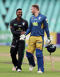 Khaya Zondo of Hollywoodbets Dolphins with David Miller of the VKB Knights during the T20 Challenge cricket match between the Hollywoodbets Dolphins and VKB Knights  at the Kingsmead stadium in Durban, KwaZulu Natal, South Africa on the 11 Dec 2016<br /> <br /> Photo by:   Steve Haag / Real Time Images