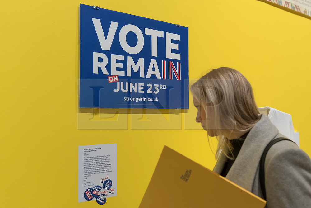 """© Licensed to London News Pictures. 27/03/2018. LONDON, UK. A visitor views material from the """"Britain Stronger in Europe"""" campaign identity, 2015/16. Preview of """"Hope to Nope: Graphics and Politics 2008-18"""", an exhibition examining the political graphic design of a turbulent decade encompassing the 2008 financial crash, Barack Obam presidency, Brexit and Donald Trump's presidency.  The exhibition takes place at the Design Museum 28 March to 12 August 2018.  Photo credit: Stephen Chung/LNP"""