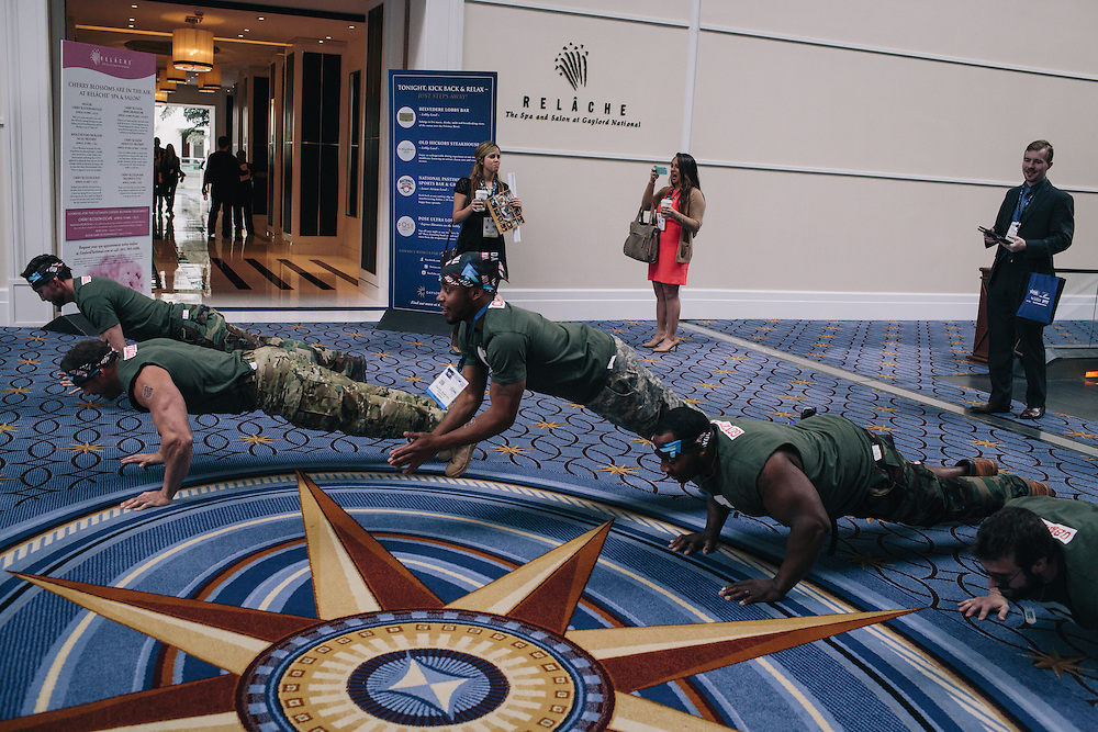 """A group from Gen Opp drop and do push ups as they roam the halls during day two of the Conservative Political Action Conference (CPAC) at the Gaylord National Resort & Convention Center in National Harbor, Md.Gen Opp and Young Americans for Liberty have partnered for CPAC to """"enlist young people to fight back against the<br /> War on Youth that the govt has waged,"""" according to Gen Opp communications and writing associate, Daisy Letendre."""