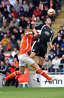 Photo: Paul Greenwood.<br />Blackpool v Bristol City. Coca Cola Championship. 18/08/2007.<br />Bristol's Michael McIndoe (R) beats Kaspars Gorkss in an aerial dual
