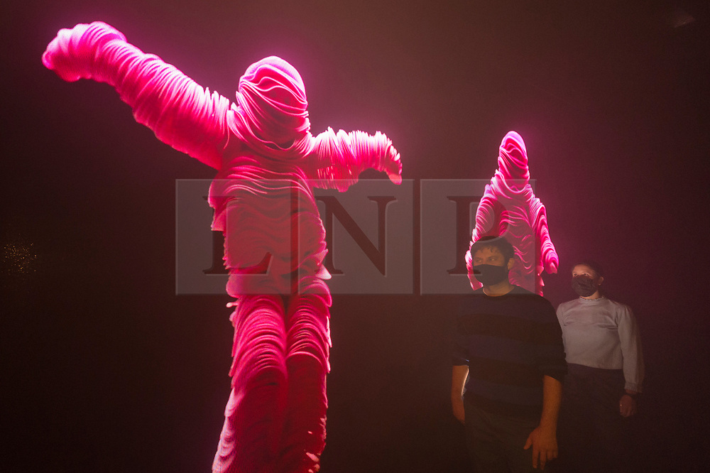 """© Licensed to London News Pictures. 28/07/2020. CITY, UK.  Staff members experience the bespoke audio visual installation of """"Got to Keep On"""", 2019, by The Chemical Brothers. Preview of """"Electronic: From Kraftwerk to The Chemical Brothers"""" at the Design Museum in Kensington which is reopening after coronavirus lockdown.  The new exhibition explores the hypnotic world of electronic music, from its origins to its futuristic dreams.  The show runs 31 July 2020 – 14 February 2021 with visitors required to adhere to strict social distancing guidelines.  Photo credit: Stephen Chung/LNP"""