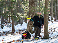 Scott Jarvis drives a shot at the Chris Daigle Memorial Disc Golf Course in Bolduc Park Friday afternoon.  (Karen Bobotas Photo/for The Laconia Daily Sun)