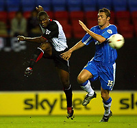 Photo. Aidan Ellis.<br />Wigan Athletic v Fulham.<br />Carling Cup 2nd Round.<br />23/09/2003.<br />Wigan's Geoff Horsfield and Fulham's Martin Djetou