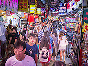 """23 DECEMBER 2012 - SINGAPORE, SINGAPORE:   Shoppers walk through the New Bugis Street market in Singapore. New Bugis Street is billed as """"the largest street-shopping location in Singapore"""". Although the street is not a well-known tourist destination, it is frequented by many Singaporeans.  PHOTO BY JACK KURTZ"""