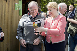 May 7, 2017 - Berlin, Germany - Neukoelln's mayor Franziska Giffey (R) awards Dietrich Kunte (L), owner of the winner rooster, at the end of a 'Rooster crowing competition' hold in the district of Neukoelln in Berlin, Germany on May 7, 2017. The competition has been organized for the 29th time from the local 'Rudow's home and land owners association' and was won from the rooster 'Oskar' which competed with other 59 roosters and was able to crow 72 times in 45 minutes. (Credit Image: © Emmanuele Contini/NurPhoto via ZUMA Press)