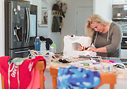 FORESTDALE -  Lauren Neidigh, owner of the apparel line Cape Camo, disassembles her unsold inventory and is turning the fabric into protective masks for healthcare workers at nursing facilities on Thursday, March 26, 2020.