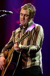David Grey plays a Concert to a sellout Sheffield Hallam FM Arena  November 29 2002 Friday<br /><br />Copyright Paul David Drabble<br />Freelance Photographer<br />07831 853913<br />0114 2468406<br />www.pauldaviddrabble.co.uk<br /> [#Beginning of Shooting Data Section]<br />Nikon D1 <br /> 2002/11/29 21:59:49.3<br /> JPEG (8-bit) Fine<br /> Image Size:  2000 x 1312<br /> Color<br /> Lens: 80-200mm f/2.8-2.8<br /> Focal Length: 112mm<br /> Exposure Mode: Manual<br /> Metering Mode: Spot<br /> 1/125 sec - f/2.8<br /> Exposure Comp.: 0 EV<br /> Sensitivity: ISO 400<br /> White Balance: Auto<br /> AF Mode: AF-S<br /> Tone Comp: Normal<br /> Flash Sync Mode: Not Attached<br /> Color Mode: <br /> Hue Adjustment: <br /> Sharpening: Normal<br /> Noise Reduction: <br /> Image Comment: <br /> [#End of Shooting Data Section] David Grey plays a Concert to a sell out Sheffield Hallam FM Arena November 29 2002 Friday<br /> <br /> Copyright Paul David Drabble<br /> Freelance Photographer<br /> 07831 853913<br /> 0114 2468406