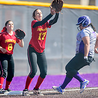 Española Valley Sundevils Tayler Suazo (8), left, and Elena Gonzales (17) await the third base throw as Miyamura Patriot Amber Mecale (17) arrives safe at Miyamura High School in Gallup Thursday.