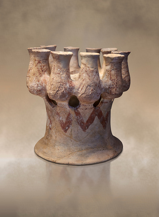 Cycladic Kernos a multiple vessel in a base.  Early Cycladic III (2300-2000 BC) , Phylakopi, Melos. National Archaeological Museum Athens. Cat No 5829.<br /> <br /> This complex vessel was used for ritual offerings. During this period pottery was plainer with simple geometric decorations. Depicts of birds or lowers were rare. .<br /> <br /> If you prefer to buy from our ALAMY PHOTO LIBRARY  Collection visit : https://www.alamy.com/portfolio/paul-williams-funkystock/cycladic-art-artefacts.html Type into the LOWER SEARCH WITHIN GALLERY box to refine search by adding background colour, place, museum etc<br /> <br /> Visit our CYCLADIC CIVILISATIONS PHOTO COLLECTIONS for more photos to download or buy as wall art prints https://funkystock.photoshelter.com/gallery-collection/Cycladic-civilisation-Ancient-Greek-Artefacts-art-Photos-Pictures-Images/C0000CmevVvnC.XU