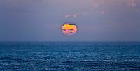 Orange sun setting over the Pacific Ocean panorama