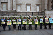 Pro-veganism animal welfare protest in London, England, United Kingdom. These vegan protesters show pictures of both domestic pets and other animals which we normally consider are species we associate with meat and killing for consumption, asking the question, what is the difference?