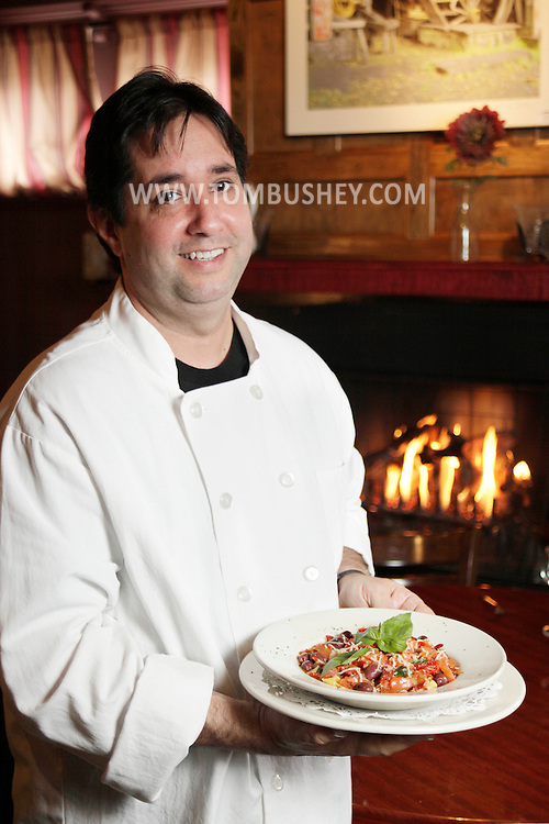 """Jorgenson's Head Chef Chris Walsh holds his Pappardelle Pasta Fresca at the Dimmick Inn in Milford, Pa., on Wednesday, Oct. 7, 2009.  He describes his Pappardelle Pasta Fresca: """"It's full of flavor with fresh garlic, calamari olives, sundried tomatoes and extra virgin olive oil. It's delicious and the pasta is fresh."""""""