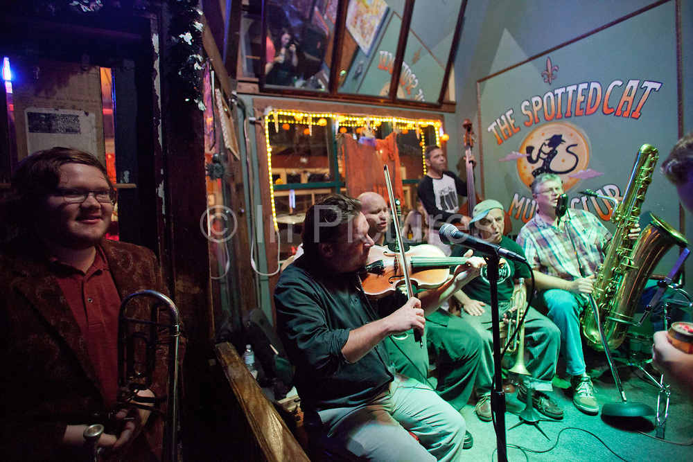 Jazz musicians playing in the Spotted Cat jazz bar on Frenchman street, New Orleans, Louisiana, USA.
