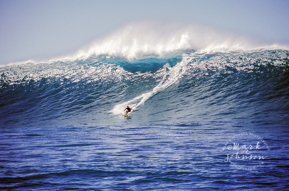 Tow-in Surfing a huge wave, Kauai, Hawaii ***Model Release available