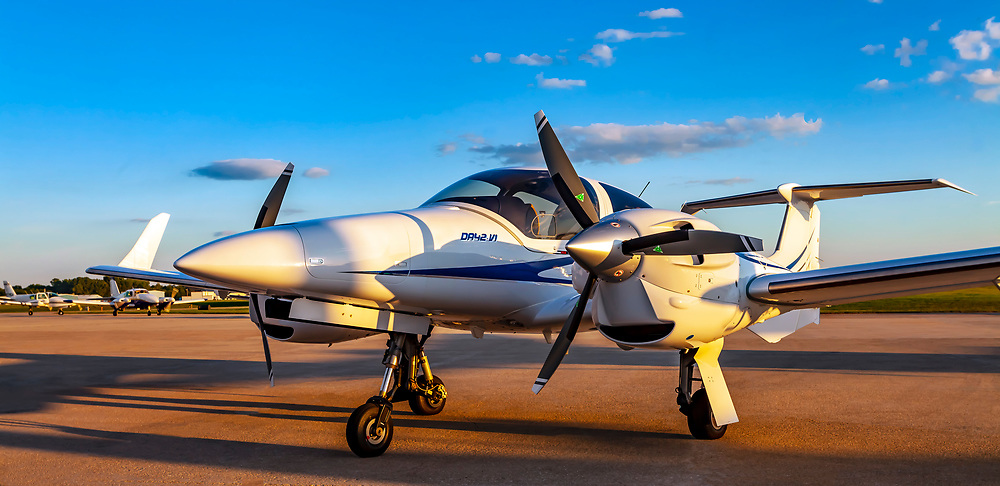 Diamond DA42-VI, photographed at Wittman Field during AirVenture 2013 in Oshkosh, Wisconsin.  <br /> <br /> Created by aviation photographer John Slemp of Aerographs Aviation Photography. Clients include Goodyear Aviation Tires, Phillips 66 Aviation Fuels, Smithsonian Air & Space magazine, and The Lindbergh Foundation.  Specialising in high end commercial aviation photography and the supply of aviation stock photography for advertising, corporate, and editorial use.