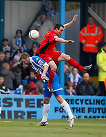 Photo: Richard Lane/Richard Lane Photography. <br /> Colchester United v Coventry City. Coca Cola Championship. 19/04/2008. City's Michael Misfid gets above United's Karl Duguid to win the ball.