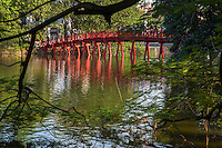 """Huc Bridge or """"bridge where light is absorbed"""" over Hoan Kiem Lake or the Lake of the Returned Sword is located in the historical center of Hanoi.  The lake is one of the major scenic spots in the city and also serves as the center for its public life."""