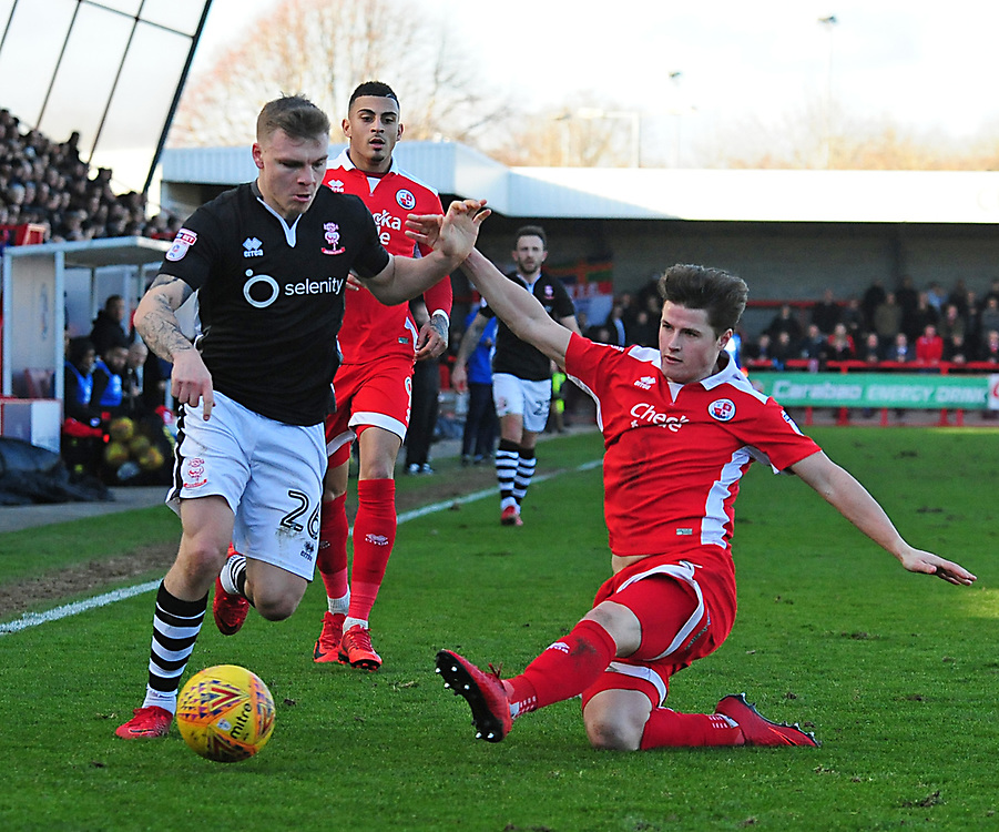 Lincoln City's Harry Anderson vies for possession with Crawley Town's Josh Doherty<br /> <br /> Photographer Andrew Vaughan/CameraSport<br /> <br /> The EFL Sky Bet League Two - Crawley Town v Lincoln City - Saturday 17th February 2018 - Broadfield Stadium - Crawley<br /> <br /> World Copyright © 2018 CameraSport. All rights reserved. 43 Linden Ave. Countesthorpe. Leicester. England. LE8 5PG - Tel: +44 (0) 116 277 4147 - admin@camerasport.com - www.camerasport.com